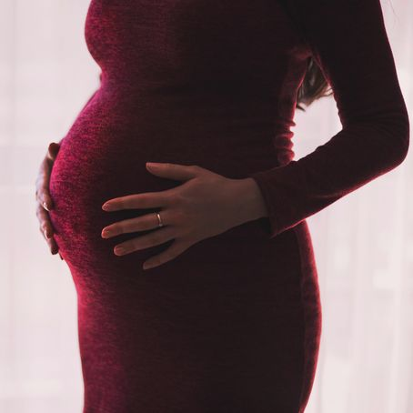 pregnant lady in red dress - Ideal Weight For Pregnancy - ideal weight for pregnancy